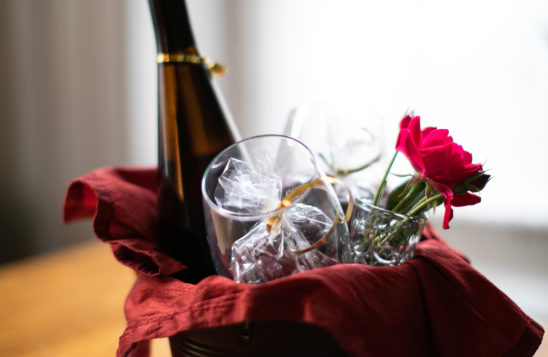 Wine and flowers in a carrier