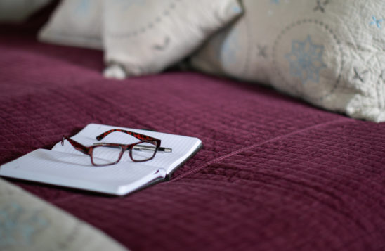 bed with glasses on them